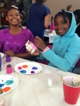 Creating some recyclable art--bird houses made from milk cartons.